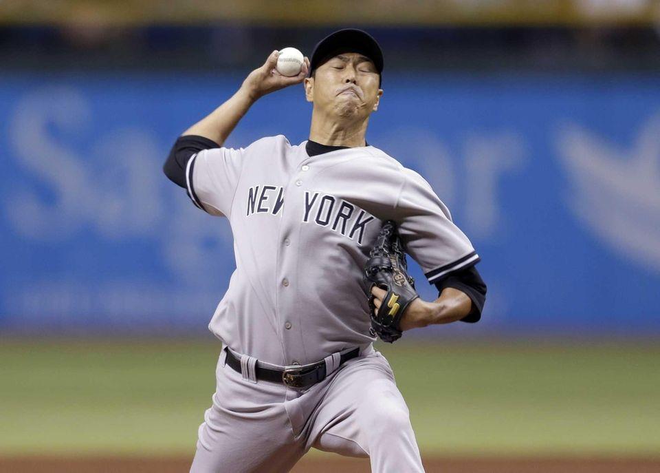 Yankees starting pitcher Hiroki Kuroda delivers to Tampa