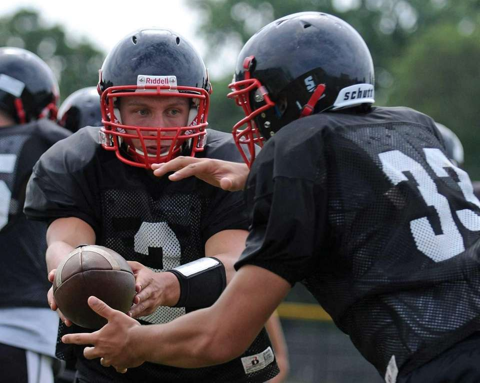Plainedge High School quarterback Nick Frenger, left, hands