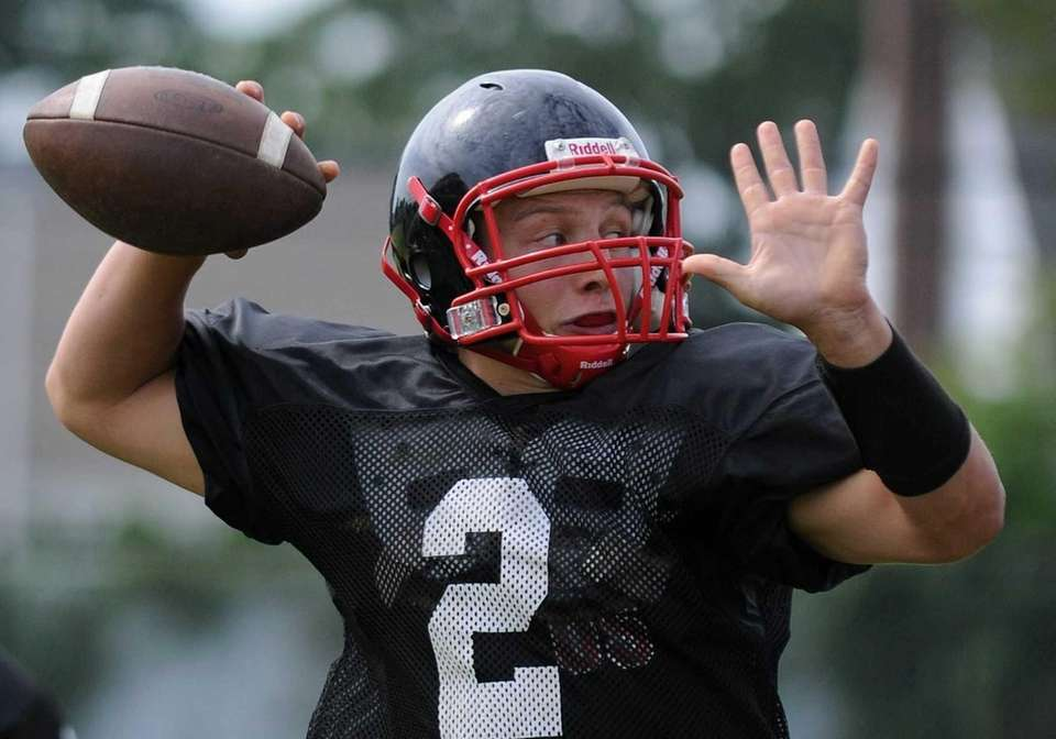 Plainedge High School quarterback Nick Frenger throws a