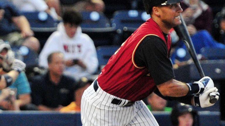 Yankees shortstop Derek Jeter reacts after making contact