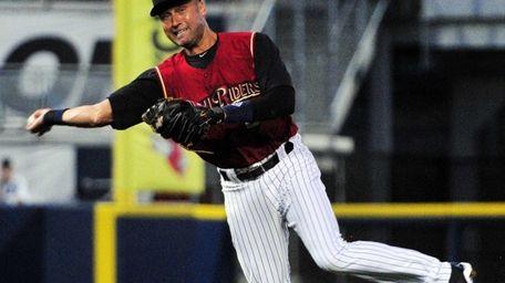 Yankees shortstop Derek Jeter throws the ball to