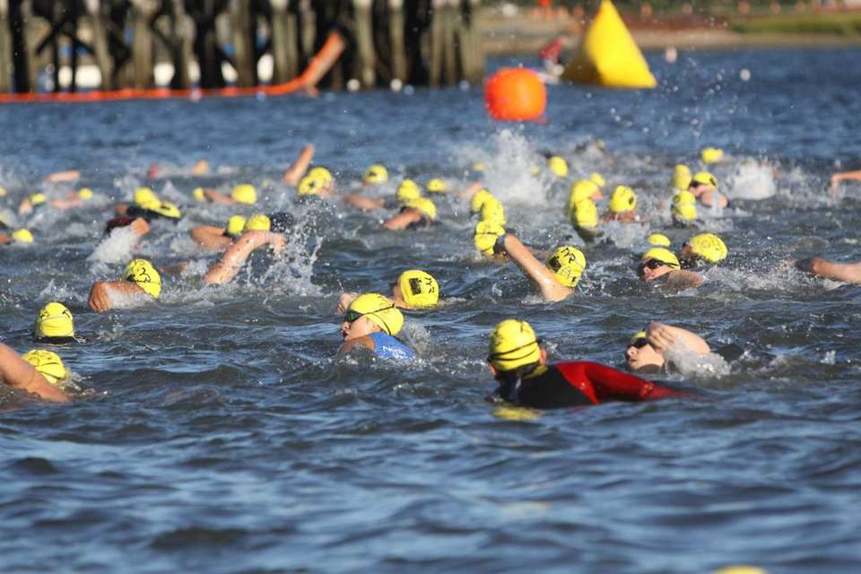 Competitors swim during the 26th Annual Runner's Edge