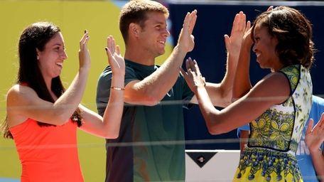 Christina McHale and Ryan Harrison give Michelle Obama