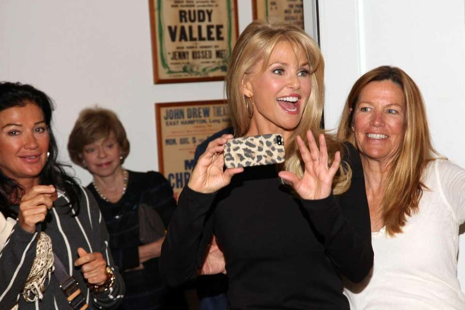 Christie Brinkley takes photos at the