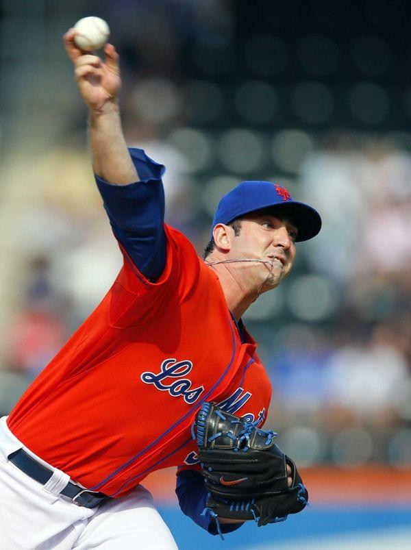 Mets starting pitcher Matt Harvey throws in the