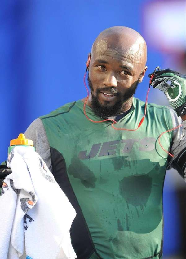 Santonio Holmes looks on before a preseason game