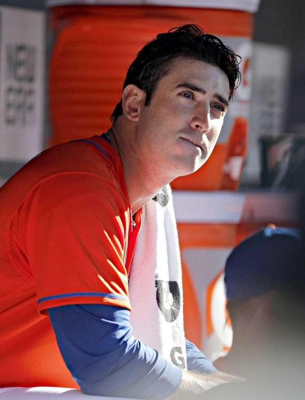 Mets starting pitcher Matt Harvey sits in the