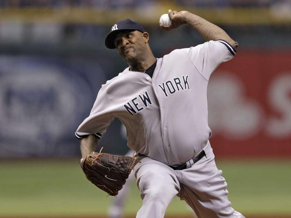 Yankees starting pitcher CC Sabathia delivers to Tampa