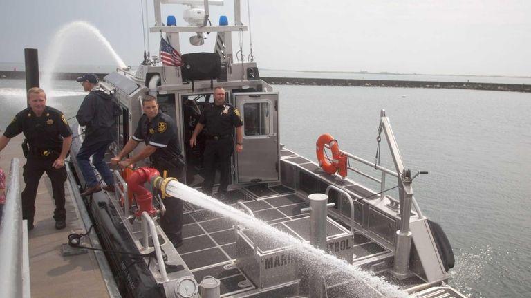 Deputy Sheriff Marco Calise demonstrates a fire monitor