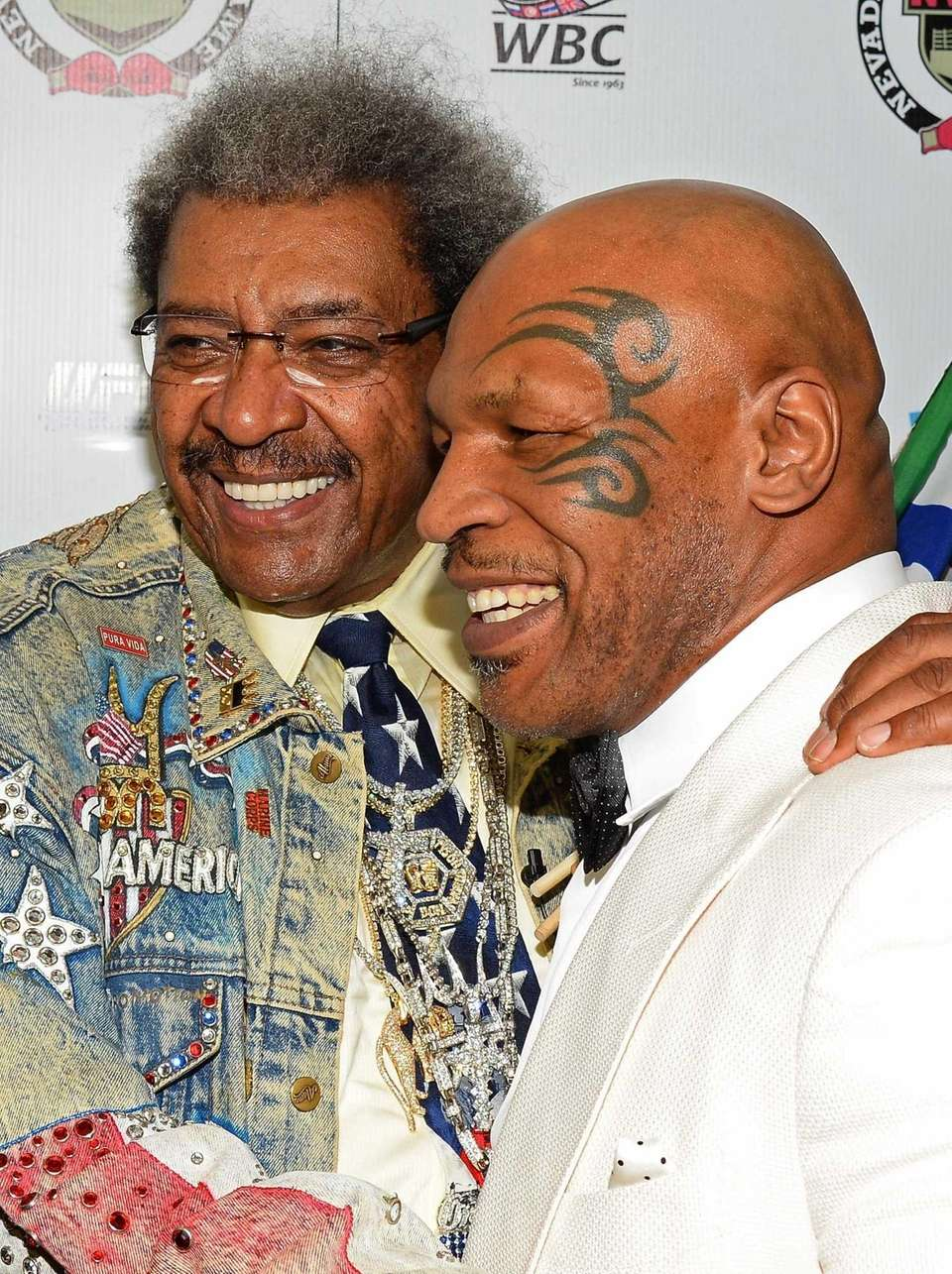Boxing promoter and inductee Don King, left, and