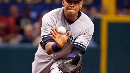 Infielder Alex Rodriguez #13 of the Yankees fields