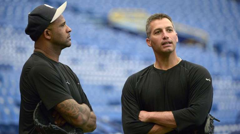 CC Sabathia, left, and Andy Pettitte chat before