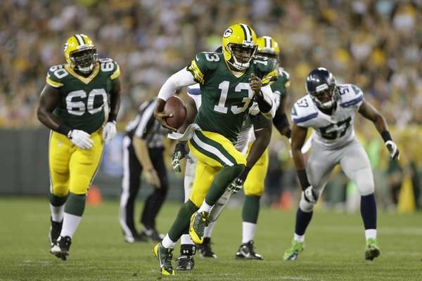 Green Bay Packers quarterback Vince Young runs the