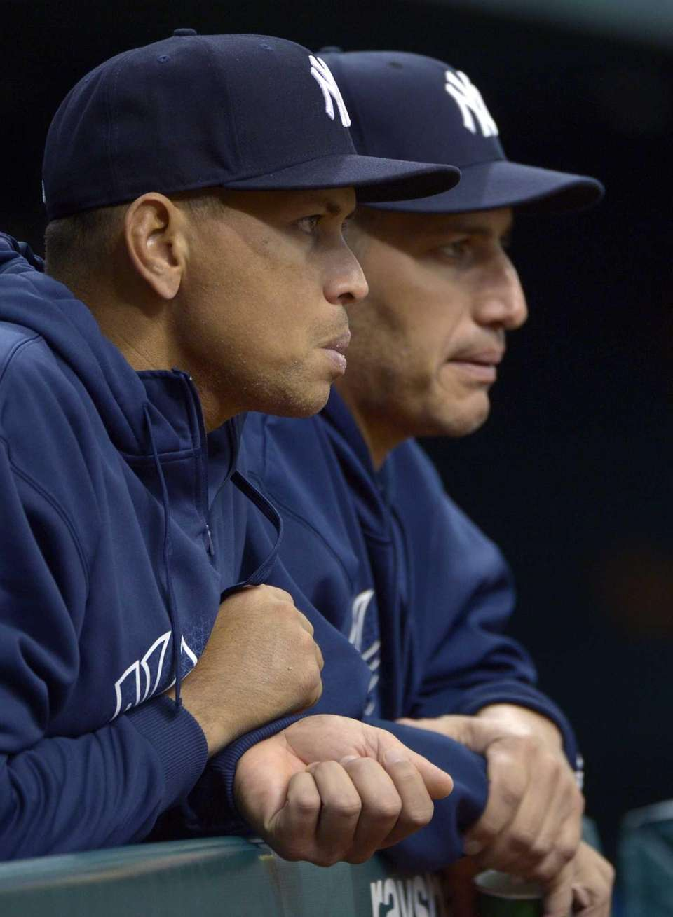 Alex Rodriguez, left, and Andy Pettitte watch from