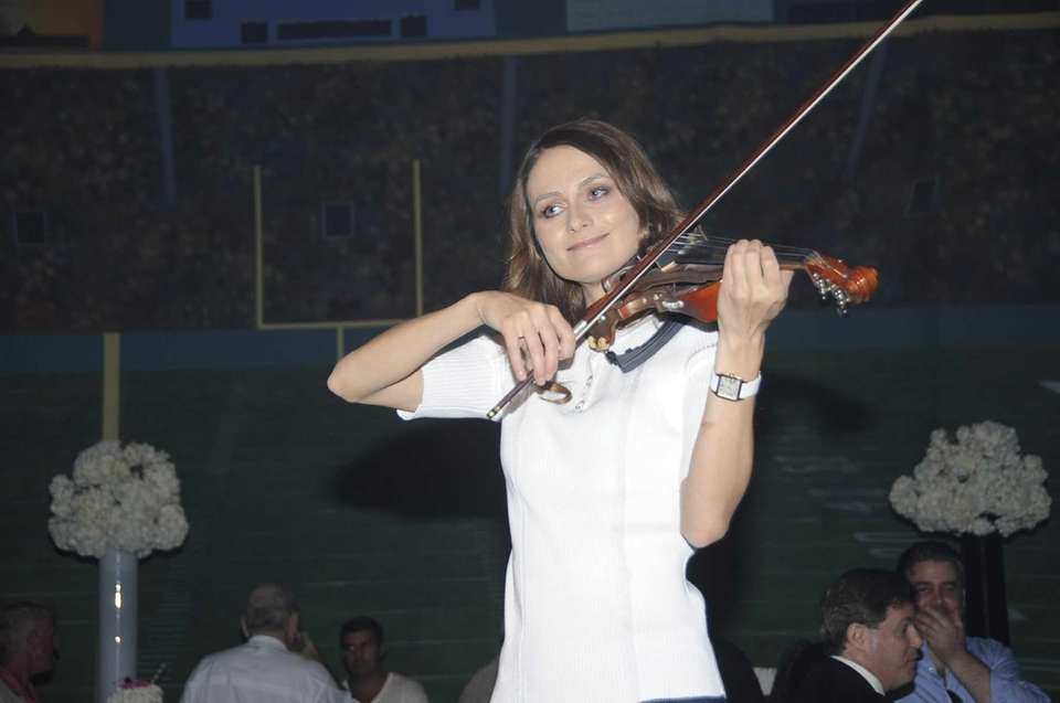 At the East Hampton Studios, violinists greeted attendees