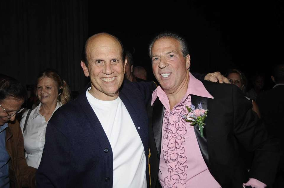 Wall Streeters Michael Milken and Glenn Myles stop