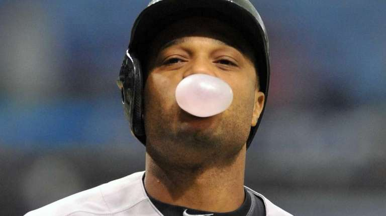 Robinson Cano blows a bubble after taking a