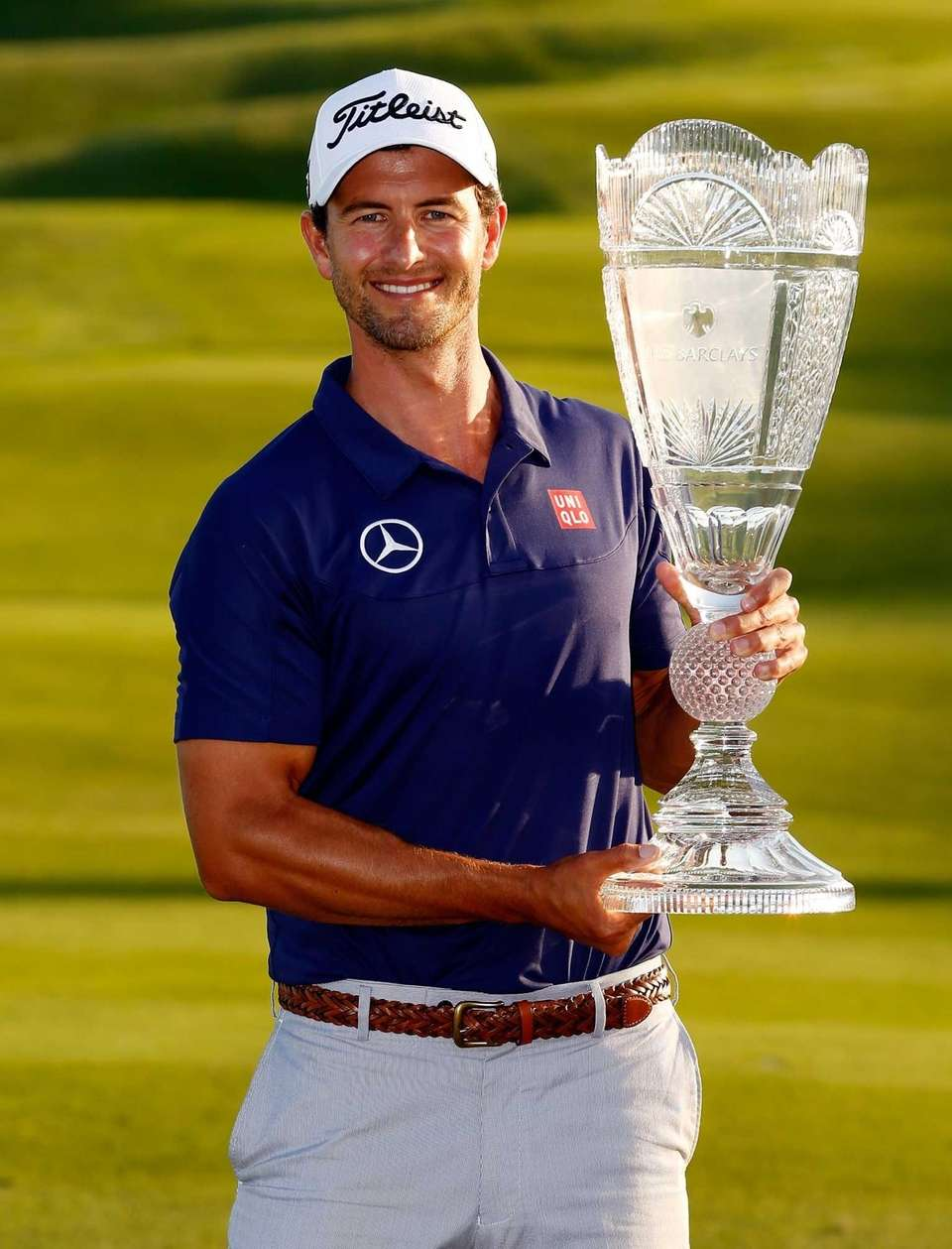 Adam Scott of Australia poses with the trophy
