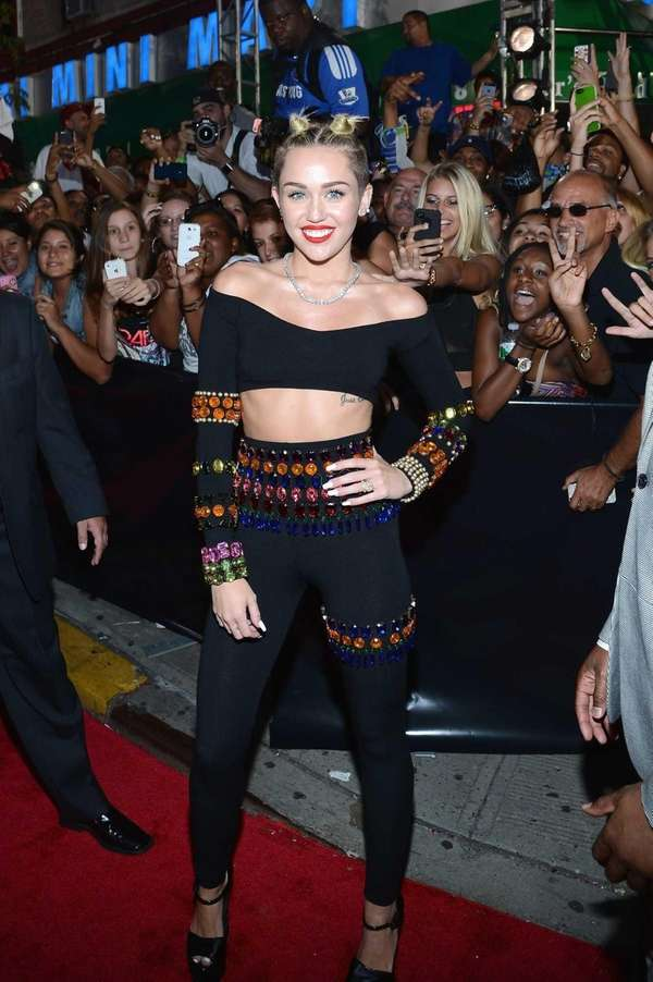 Miley Cyrus, in a gem-covered black crop top