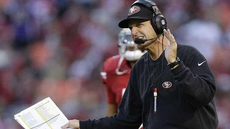 San Francisco 49ers head coach Jim Harbaugh reacts