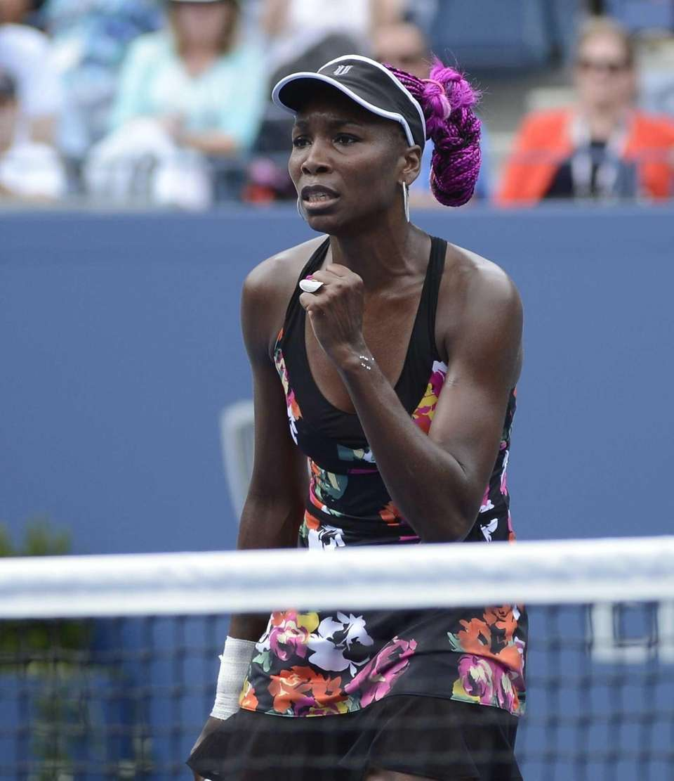 Venus Williams reacts to winning a point against