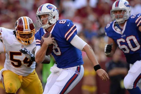 Buffalo Bills quarterback Jeff Tuel rushes past Washington