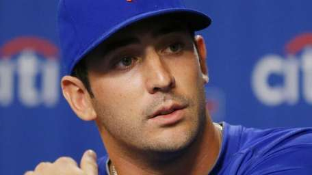 Matt Harvey speaks during a news conference announcing