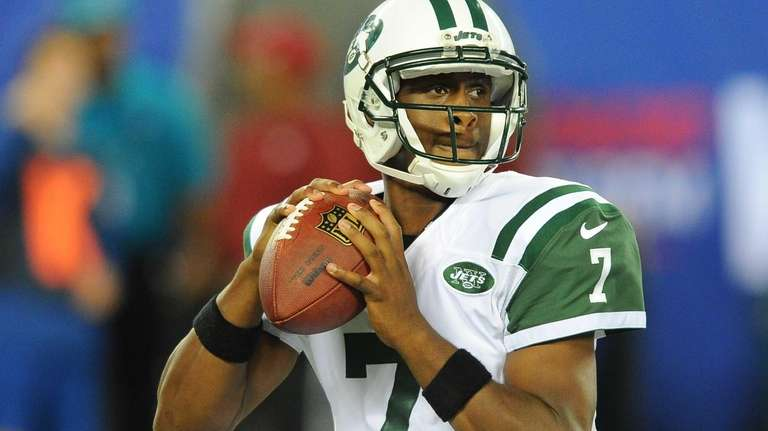 Geno Smith looks to pass during the second