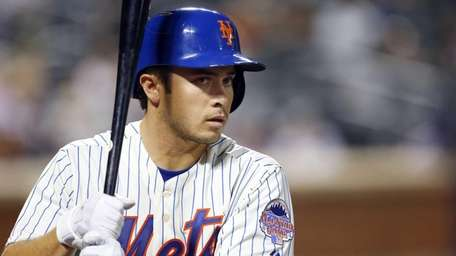 Travis d'Arnaud waits to bat in the second