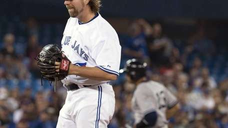 Toronto Blue Jays starting pitcher R.A. Dickey reacts