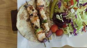 The salmon kebab, on a wood skewer, is