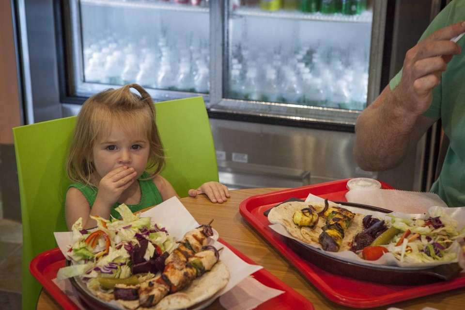 Lena Sullivan, almost 2, eating her kebab at