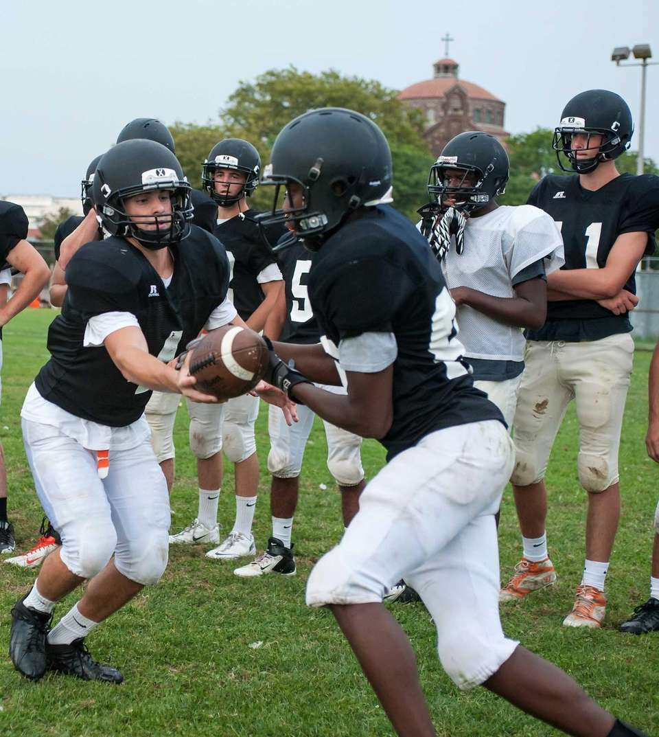 Babylon's football team goes through drills at training