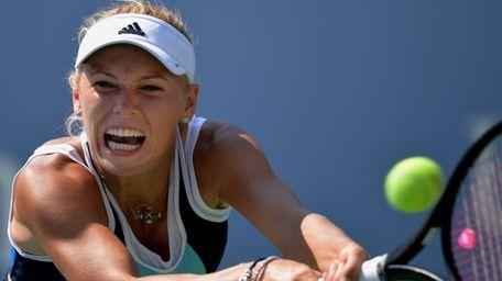 Caroline Wozniacki returns a shot to Ying-Ying Duan