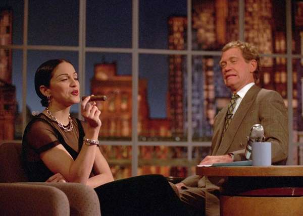Madonna puffs on a cigar while David Letterman
