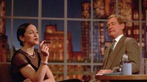 Madonna puffs on a cigar while David Letterman