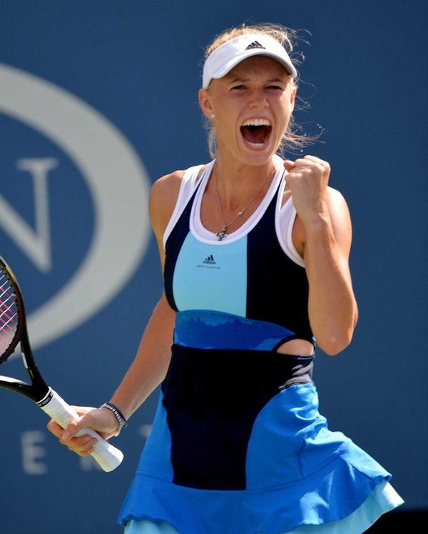 Caroline Wozniacki celebrates a win over Ying-Ying Duan