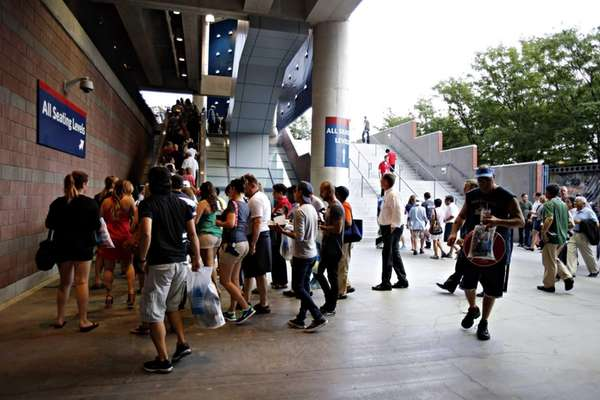 Spectators enter Arthur Ashe Stadium for the Opening