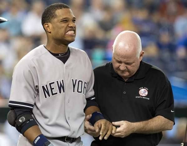 Robinson Cano is tended to by trainer Steve