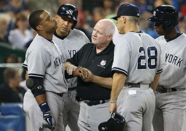 Robinson Cano of the Yankees reacts after being