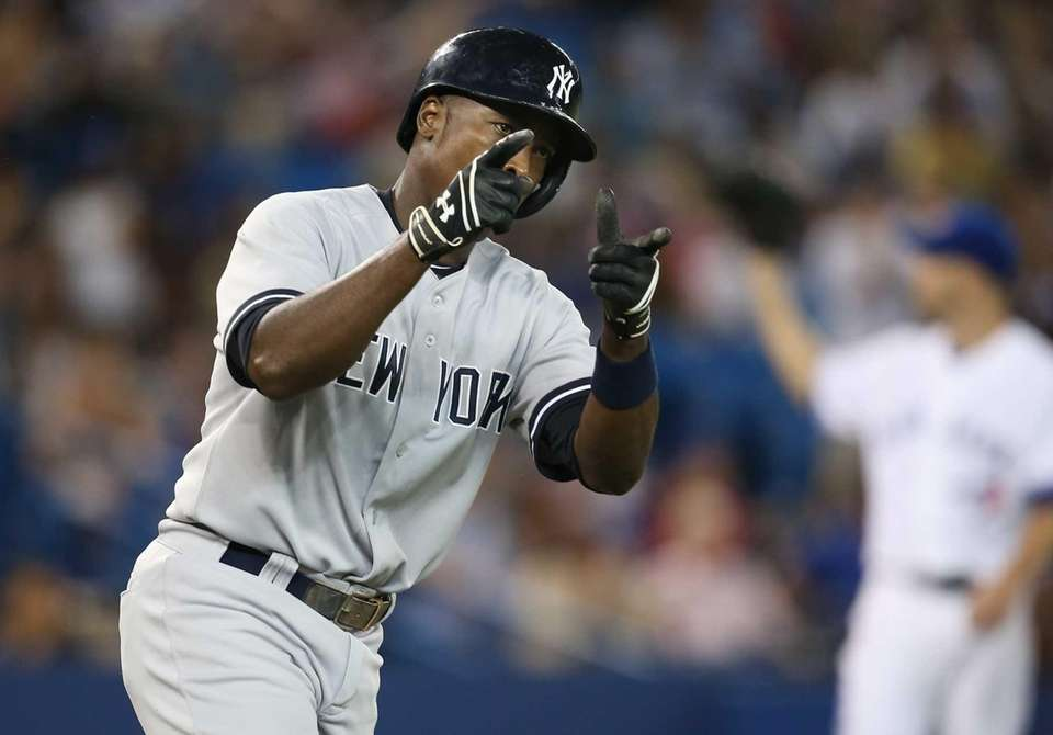 Alfonso Soriano of the Yankees celebrates his three-run