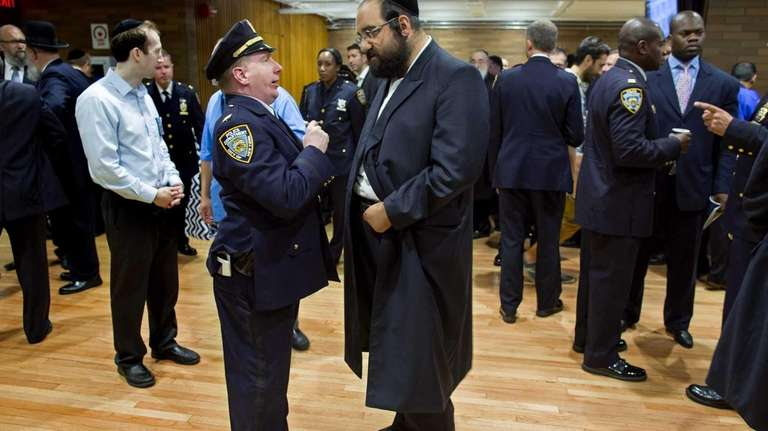 NYPD Capt. Wilson of the 7th Precinct, left,