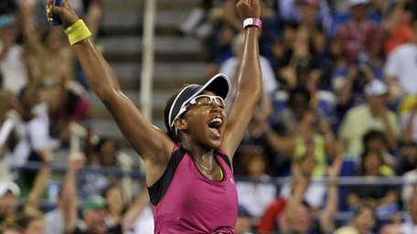 Victoria Duval celebrates after defeating Samantha Stosur during