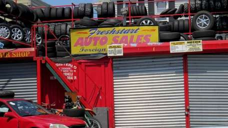 Federal agents raided the auto sales business on