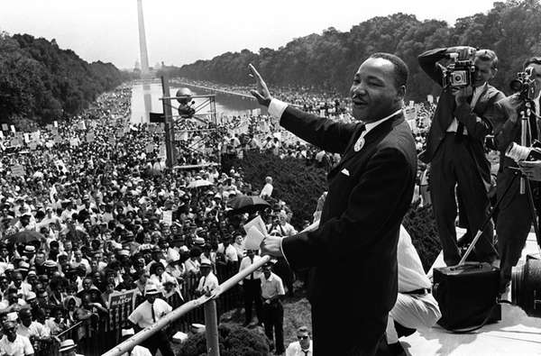 U.S. civil rights leader Martin Luther King waves