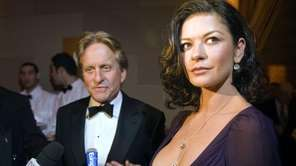 Michael Douglas and Catherine Zeta-Jones attend a ceremony