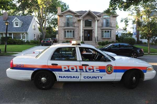 Nassau County Police guard a scene in New