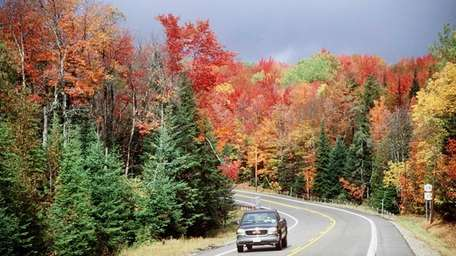 Fall colors line the roads near Indian Lake