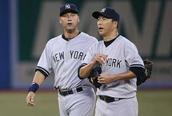 Hiroki Kuroda of the Yankees is consoled by