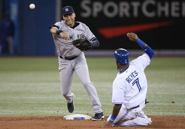 Derek Jeter of the Yankees turns a double